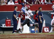 Trent Nelson  |  The Salt Lake Tribune Utah's DeVonte Christopher runs into the end zone for a touchdown during the first half as Utah faces Arizona, college football at Arizona Stadium in Tucson, Arizona, Saturday, November 5, 2011.