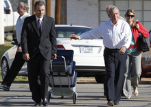 Fredrick Merril Jessop, right, and his attorney Rae Leifeste walk to the Coke County Courthouse on Tuesday, Nov. 1, 2011 in Robert Lee, Texas. in Robert Lee, Texas, Tuesday, Nov. 1, 2011 to start the first day of testimony of his trial. Jessop, 75, is a former bishop of the polygamist Fundamentalist Church of Jesus Christ of Latter Day Saints. He is is accused of marrying an underage girl to group leader Warren Jeffs in 2006.  (AP Photo/San Angelo Standard-Times, Patrick Dove)