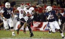 Trent Nelson  |  The Salt Lake Tribune Utah's Conroy Black (9) runs back an interception during the second half as Utah faces Arizona, college football at Arizona Stadium in Tucson, Arizona, Saturday, November 5, 2011.