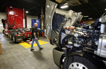 Steve Griffin  |  Tribune file photo Freightliner trucks get serviced in the England trucking garage in 2009. Dan England, chairman of C.R. England Inc., has been elected chairman of the American Trucking Associations for a one-year term.