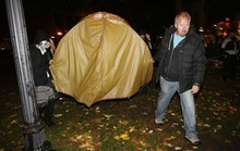 Trent Nelson  |  The Salt Lake Tribune Activists carry off a tent as Salt Lake City police cleared the Occupy Salt Lake tent city from Pioneer Park in Salt Lake City, Utah, Saturday, November 12, 2011.