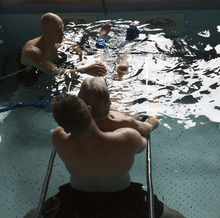 Steve Griffin  |  The Salt Lake Tribune   Brooke Hopkins, who was paralyzed from a bicycle accident three years ago, works with physical therapist Matt Hansen and LMT/PT Aide Mike Erickson during pool therapy at Neuroworx in South Jordan, Utah Friday, November 11, 2011.