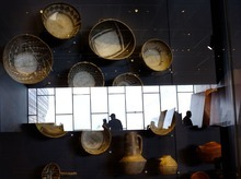 Steve Griffin  |  The Salt Lake Tribune   People are reflected onto a display case of pots in the new Natural History Museum of Utah in Salt Lake City, Utah Saturday, November 5, 2011.