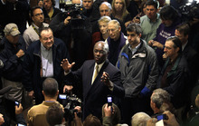 Republican presidential candidate Herman Cain speaks to local residents during a campaign stop at Manna Java World Cafe, Tuesday, Nov. 15, 2011, in Dubuque, Iowa. (AP Photo/Charlie Neibergall)