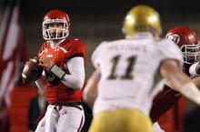 Utah quarterback Jon Hays (9) looks for a receiver during the second half of am NCAA college football game against UCLA  in Salt Lake City, on Saturday, Nov. 12, 2011. Utah won 31-6. (AP Photo/Jim Urquhart)