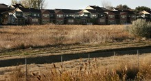 Steve Griffin  |  The Salt Lake Tribune Garbett Homes is suing Farmington because the developer wants to build a new section of lease-to-own homes.  Residents who have already bought into the development are upset because they want owner-occupied properties.