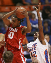 Utah's Dijon Farr, left, grabs a defensive rebound against Boise State's Kenny Buckner during an NCAA college basketball game Wednesday, Nov. 16, 2011, in Boise, Idaho. (AP Photo/The Idaho Statesman, Chris Butler)