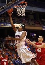 Boise State's Ryan Watkins (23) drives in for a layup against Utah's Jason Washburn (42) during the first half of an NCAA college basketball game on Wednesday, Nov. 16, 2011, in Boise, Idaho. (AP Photo/Joe Jaszewski)
