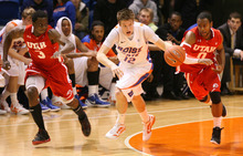 Boise State's Igor Hadziomerovic, center, leads a fast break as Utah's Anthony Odunsi, left, and Chris Hines defend during an NCAA college basketball game Wednesday, Nov. 16, 2011, in Boise, Idaho. (AP Photo/The Idaho Statesman, Chris Butler)