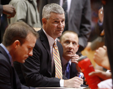 Boise State head coach Leon Rice, top, talks to his team during a time out against Utah during the first half of an NCAA college basketball game on Wednesday, Nov. 16, 2011, in Boise, Idaho. (AP Photo/Joe Jaszewski)
