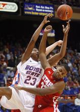 Boise State's Ryan Watkins (23) reaches for a rebound against Utah's George Matthews (32) during the first half of an NCAA college basketball game Wednesday, Nov. 16, 2011, in Boise, Idaho. (AP Photo/Joe Jaszewski)