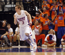 Boise State's Anthony Drmic (3) celebrates a basket in the second-half against Utah during the first half of an NCAA college basketball game on Wednesday, Nov. 16, 2011, in Boise, Idaho. (AP Photo/Joe Jaszewski)