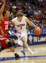 Boise State's Anthony Drmic (3) drives to the basket against Utah's Dijon Farr (10) during the first half of an NCAA college basketball game Wednesday, Nov. 16, 2011, in Boise, Idaho. (AP Photo/Joe Jaszewski)