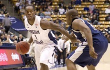 BYU's Charles Abouo drives on Longwood's Durann Neil. BYU defeated Longwood 92-60 in the Marriott Center in Provo, Utah. Photo By Jaren Wilkey/BYU