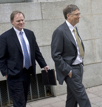 Al Hartmann  |  The Salt Lake Tribune Bill Gates, right, is escorted by John Pinette from federal court in Salt Lake City on Monda, Nov. 21 after the first day testimony in a lawsuit pitting Novell against Microsoft.