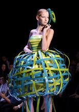 A model showcases a creation by PJ College of Arts & Design during the Malaysia International Fashion Week in Kuala Lumpur, Malaysia, Monday, Nov. 21, 2011. (AP Photo/Lai Seng Sin)