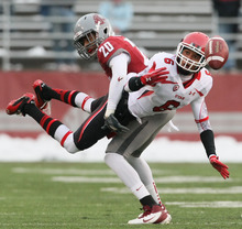 Chris Detrick  |  The Salt Lake Tribune Utah Utes wide receiver Dres Anderson (6) and Washington State Cougars safety Deone Bucannon (20) go for the ball during the first half of the game at Martin Stadium at Washington State University Saturday November 19, 2011. The game is tied 7-7.
