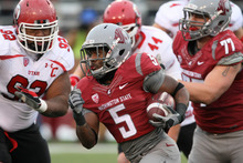 Chris Detrick  |  The Salt Lake Tribune Washington State Cougars defensive end Brandon Rankin (5) runs past Utah Utes defensive tackle Star Lotulelei (92) during the first half of the game at Martin Stadium at Washington State University Saturday November 19, 2011. The game is tied 7-7.