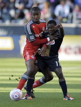 Michael Perez  |  The Associtated Press Toronto FC's Andy Iro (3) collides with Philadelphia Union's Freddy Adu (11) during the first half of an MLS soccer match Oct. 15 in Chester, Pa.