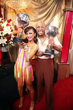 In this image released by ABC-TV, war veteran and actor J.R. Martinez, right, and his partner Karina Smirnoff hold their awards after they were crowned champions of the celebrity dance competition series,
