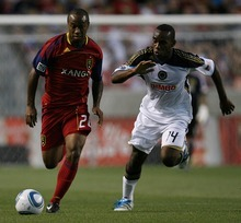 Djamila Grossman  |  The Salt Lake Tribune  Real Salt Lake plays Philadelphia Union at Rio Tinto Stadium in Sandy, Utah, on Saturday, Sept. 3, 2011. RSL's Collen Warner (26) is being guarded by Philadelphia's Amobi Okugo (14) in the second half.