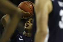 Chris Detrick  |  The Salt Lake Tribune Brigham Young Cougars forward Brandon Davies (0) shoots a free throw during the second half of the game at the Dee Glen Smith Spectrum Friday November 11, 2011. Utah State won the game 69-62.