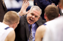 BYU head coach Dave Rose talks to his players during a timeout against Prairie View A&M in an NCAA college basketball game at the Marriott Center in Provo, Utah, on Tuesday, Nov. 22, 2011. (AP Photo/The Daily Herald, Spenser Heaps)
