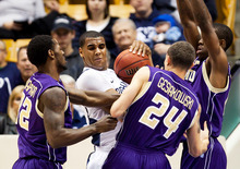 BYU's Brandon Davies, second left, fends off Prairie View A&M's Demondre Chapman, left, and Ryan Gesiakowski during an NCAA college basketball game at the Marriott Center in Provo, Utah, on Tuesday, Nov. 22, 2011. (AP Photo/The Daily Herald, Spenser Heaps)