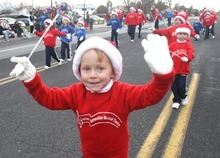 Rick Egan  | The Salt Lake Tribune   Noah Thomas, 5, marches with Miss Margene's creative generation musical theater, in the West Valley Christmas Parade, Friday, November 25, 2011.