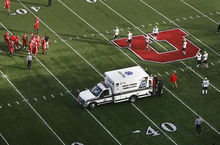 Scott Sommerdorf  |  The Salt Lake Tribune              Utah players watch as an ambulance carrying team mate OL Sam Brenner leaves the field after the beginning of the second half Friday, Nov. 25, 2011.