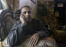 Al Hartmann  |  The Salt Lake Tribune Almoh Bahaji ponders the death of his nephew, Omar Sharif, who was allegedly murdered at the Utah State Hospital for the mentally ill last spring. After eight months, the family has felt ignored because no information about the case has been provided to them.