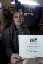 AAl Hartmann  |  The Salt Lake Tribune Almoh Bahaji ponders the death of his nephew, Omar Sharif, who was allegedly murdered at the Utah State Hospital for the mentally ill last spring. After eight months, the family has felt ignored because no information about the case has been provided to them. He holds a certificate from the hospital that states his nephew's completion of a vocational rehabiltiation program.