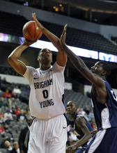 Brigham Young's Brandon Davies (0) shoots over Nevada's Dario Hunt during the first half of an NCAA college basketball game on Friday, Nov. 25, 2011, in Hoffman Estates, Ill. (AP Photo/Jim Prisching)