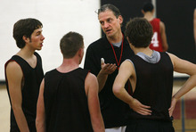 Scott Sommerdorf  |  The Salt Lake Tribune              West boys basketball coach Mike Matheson talks with his team captains for 2011, Lennon Coley, left, Zach Floisand, and Devin Price, right, at practice at West Monday, November 28, 2011.