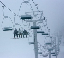 Steve Griffin     The Salt Lake Tribune   Skiers brave fog and snow as they ride the Skyline Double Chair ski lift during opening day at Eagle Point ski resort above Beaver on Dec. 15, 2010.
