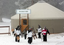 Steve Griffin     The Salt Lake Tribune   Ski instructors leave the Eagle's Nest yurt after a meeting during opening day at Eagle Point ski resort above Beaver on Dec. 15, 2010. The yurt is for children in the ski school.
