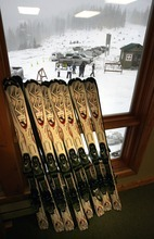 Steve Griffin     The Salt Lake Tribune   Rental skis are lined up against the window as skiers start to arrive during opening day of Eagle Point ski resort above Beaver on Wednesday, Dec. 15, 2010.