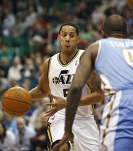 Djamila Grossman  |  The Salt Lake Tribune  The Utah Jazz' Devin Harris (5) drives toward the basket as the Denver Nuggets' Gary Forbes (0), guards him, during a game at Energy Solutions Arena in Salt Lake City, Utah, on Wednesday, April 13, 2011.