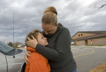 Al Hartmann  |  The Salt Lake Tribune McKayde Mortensen gives his mother Tricia Mortensen a hug as he's dropped off at school in Magna. He developed PTSD after witnessing his mother in a car accident. He doesn't get upset about getting in the car anymore, but he's still close to his mother.