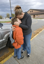 Al Hartmann  |  The Salt Lake Tribune McKayde Mortensen gives his mother Tricia Mortensen a hug as he's dropped off at school in Magna.  He developed PTSD after watching his mother get in a car accident. Now 8, he recently completed therapy and remains close to his mother.