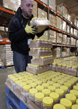 Francisco Kjolseth  |  The Salt Lake Tribune Joseph Elmore readies supplies of peanut butter at the Utah Food Bank in Salt Lake City. The peanut butter will be will be distributed to pantries statewide.