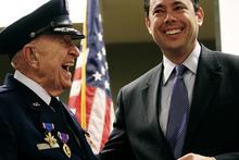 File photo courtesy Mark Johnston     The Daily Herald  Rep. Jason Chaffetz, R-Utah, laughs with WWII veteran Col. Myron