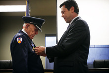 File photo courtesy Mark Johnston     The Daily Herald  Rep. Jason Chaffetz, R-Utah, pins the Purple Heart onto the uniform of Col. Myron