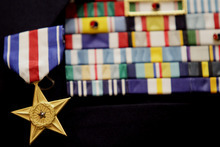 photo courtesy Mark Johnston     The Daily Herald  The Silver Star pinned onto the uniform of Col. Myron
