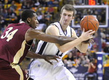 Denver forward Chris Udofia (34) tries to steal the ball from Utah State guard Adam Thoseby during an NCAA college basketball game Wednesday, Nov. 30, 2011, in Logan, Utah. (AP Photo/The Herald Journal, Eli Lucero)