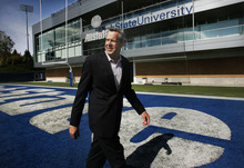 Scott Sommerdorf     The Salt Lake Tribune              Utah State athletics director Scott Barnes in the north end zone with the Laub Center in the background at Romney Stadium, Monday, October 10, 2011.