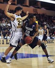 Northern Arizona's Stallon Saldivar defends BYU's Anson Winder, right, during an NCAA college basketball game, Wednesday, Nov. 30, 2011, in Prescott Valley, Ariz. The BYU won 87-52. (AP Photo/The Daily Courier, Les Stukenberg)