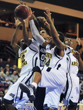 A trio of Northern Arizona defenders, including Durrell Norman (34) try to rebound against BYU's Brandon Davies during an NCAA college basketball game in Prescott Valley, Ariz., on Wednesday, Nov. 30, 2011. BYU won 87-52. (AP Photo/The Daily Courier, Les Stukenberg) MANDATORY CREDIT