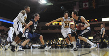 BYU's Josh Sharp, right, looks to pass to Noah Hartsock, second from left, as Northern Arizona's Darrell Norman, left and Stallon Saldivar (21) defend during an NCAA college basketball game in Prescott Valley, Ariz., on Wednesday, Nov. 30, 2011. BYU won 87-52. (AP Photo/The Daily Courier, Les Stukenberg) MANDATORY CREDIT