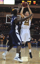 Northern Arizona's Colin Gruber shoots a 3-pointer over BYU's Charles Abouo during an NCAA college basketball game in Prescott Valley, Ariz., on Wednesday, Nov. 30, 2011. BYU won 87-52. (AP Photo/The Daily Courier, Les Stukenberg) MANDATORY CREDIT